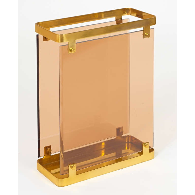 Fontana Arte. Large handsome umbrella stand by Fontana Arte Two beveled, peach-colored glass panels floating in a rectangular polished brass frame, Italy, circa 1960. Dimensions: 17 x 7 x 22 H.