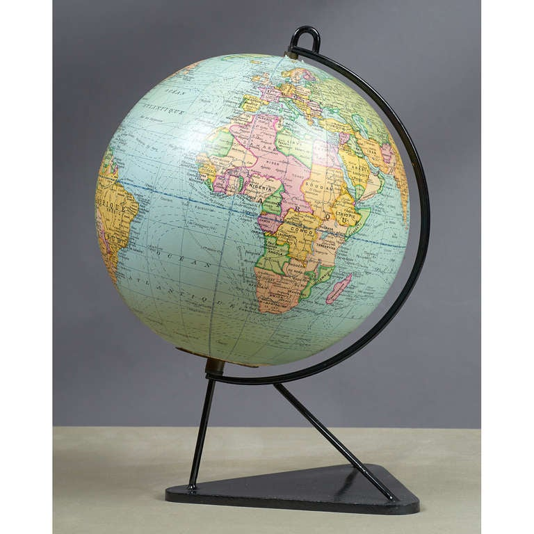France, 1950s   Glass globe on modernist wrought iron frame Imprimerie Michard , Paris  Measures: 16 H x 11 Ø.