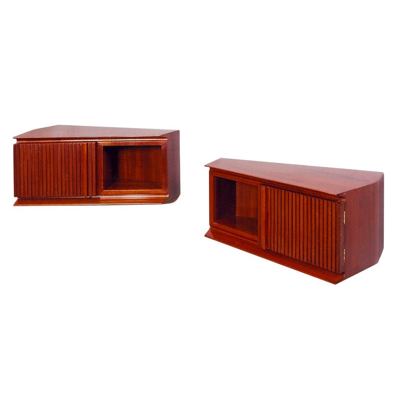 pair of wall-mounted mahogany trapezoidal bedside tables, italy