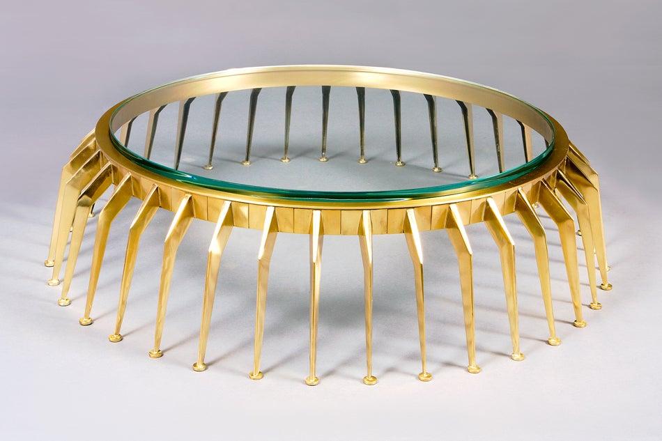 Roberto Giulio Rida (born 1943). Centipede low table. Cast and tooled bronze, inset glass. Piece unique, Italy, 2011.  Signed. 40 diameter x 10 H.