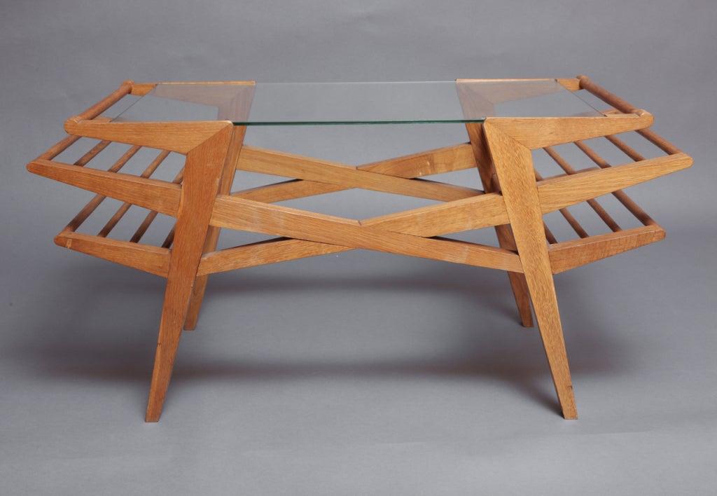 Maxime Old  (1910-1991) Sculptural coffee table in oak  France, 1950s 41 W x 19 D x 20 H Ref: Ensemble Mobiliers , Vol. 11, planche 2, 1951 Bibliotheque de l'Image