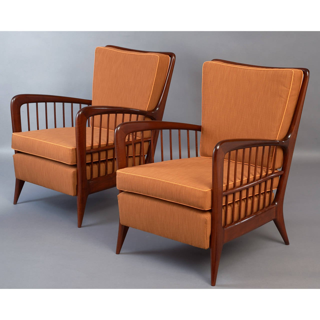 Paolo Buffa (1903-1970). Handsome pair of mahogany stained armchairs with spindled back and arms, sculpted armrests and tapered legs, Italy, circa 1940. Dimensions: 24 W x 27 D x 16 / 32 H.