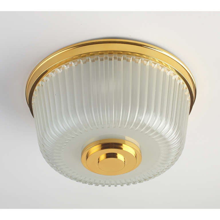 Ceiling light. Deeply ribbed glass, polished bronze mounts, Italy, 1950s. Diameter :16 diameter x 8 H. Rewired for use in the U.S. with three standard base bulbs.