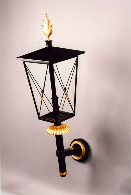 Gilbert Poillerat (1902-1988). A pair of important and massive partial gilt wrought iron lantern sconces with flame motif France, 1950s. Can be used indoor or outdoors. Dimensions: 46 H x 12 W x 22 D. Ref. Ensembles Mobiliers, 1950, Vol.10, plate