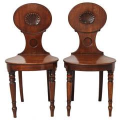 A Pair of English Regency Mahogany Hall Chairs