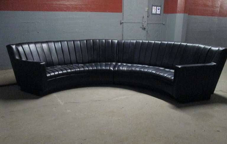 "Black leather two-piece sectional sofa designed in the manner of De Sede. Sofa has lights at the bottom with a formica base. Each sectional measures: 96"" W x 37"" H x 35"" D."