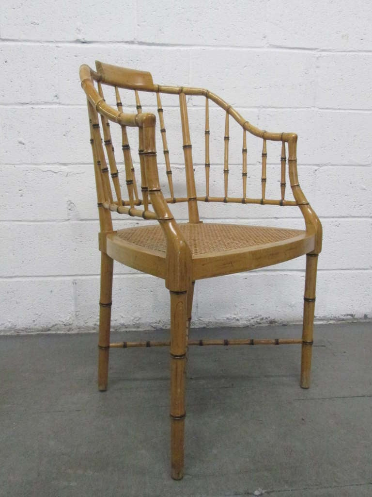 Pair of faux bamboo baker chairs with caned seats. Baker.