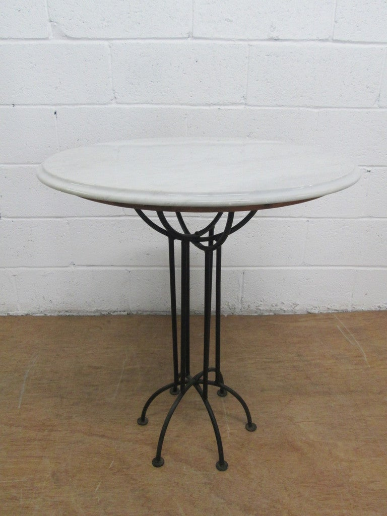 Pair of wrought iron and italian marble top tables at 1stdibs for Wrought iron table bases marble top