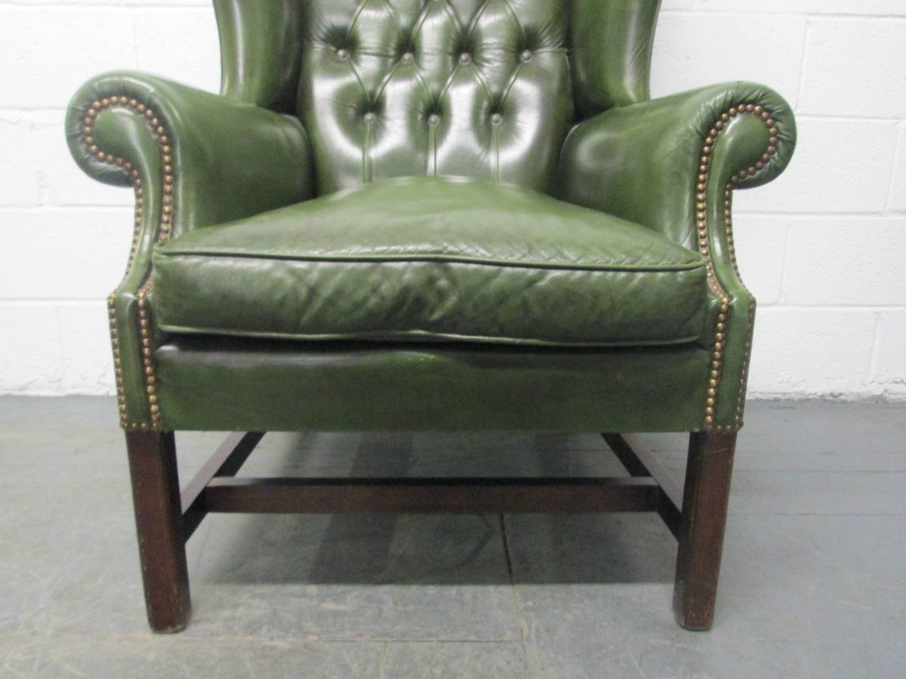 Mid 20th Century Vintage Green Leather Tufted Wingback Chair For Sale
