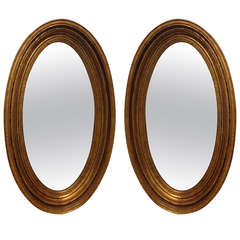 Pair of Gold Gilt Oval Mirrors