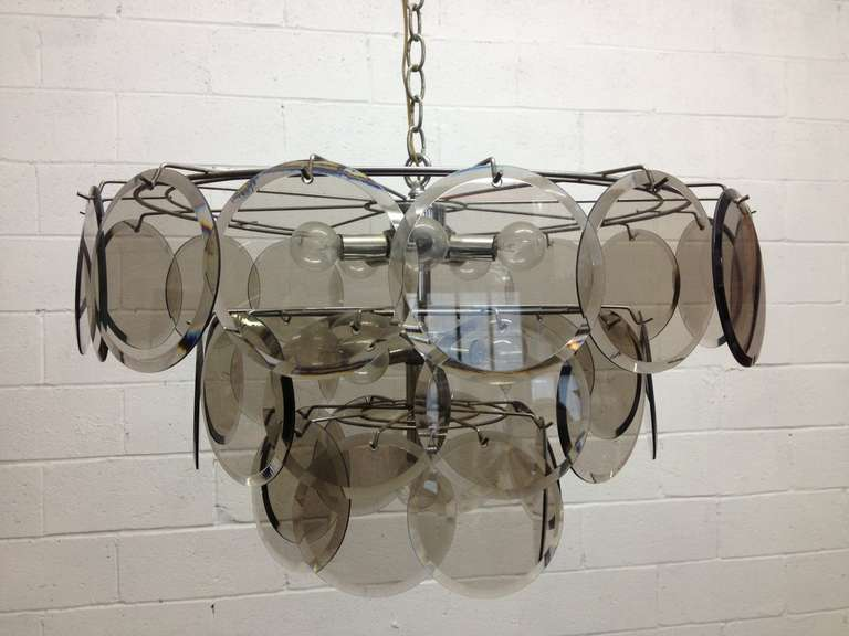 Italian, Gino Vistosi 36 Disc chandelier for Murano. Glass discs are beveled. Measures: 25W (at it's widest) x 14.5H.