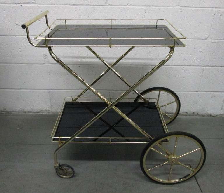 Two-Tier Bar Cart with smoked glass tops and metal frame. Trolley.