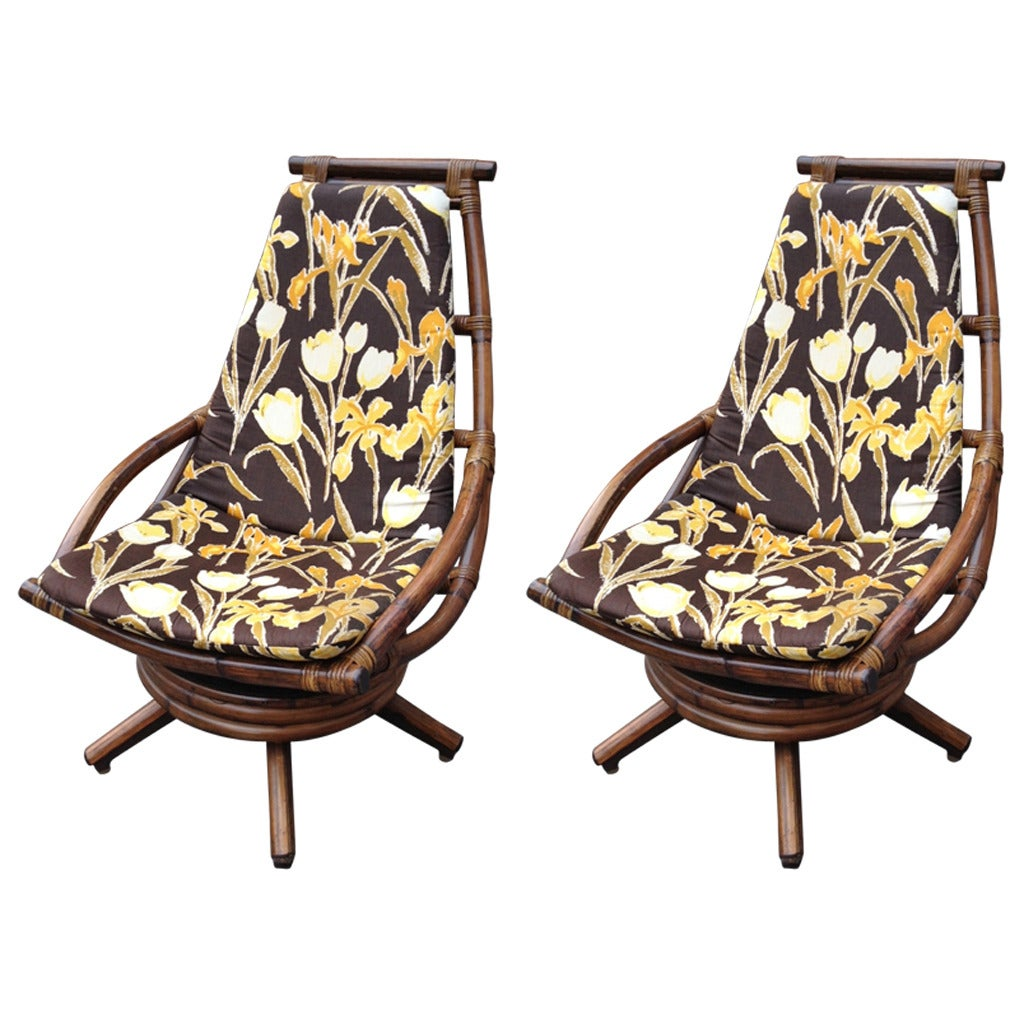 Pair of vintage rattan swivel lounge chairs for sale at 1stdibs