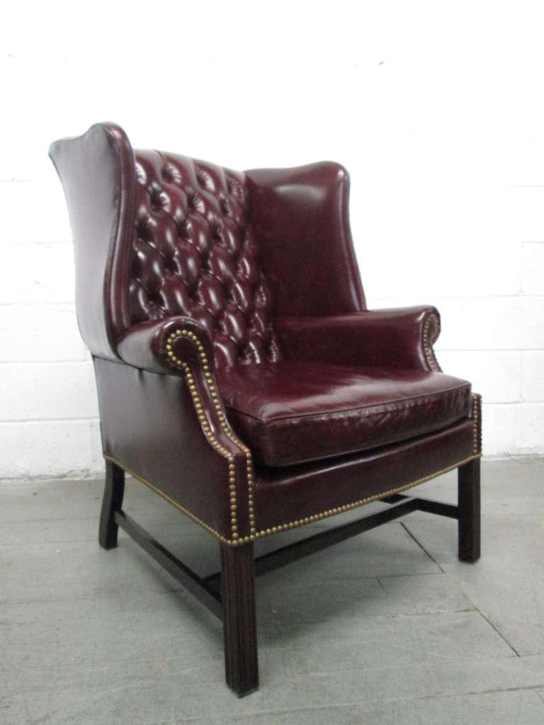 Pair Of Burgundy Leather Tufted Wingback Chairs. Has Brass Studs,