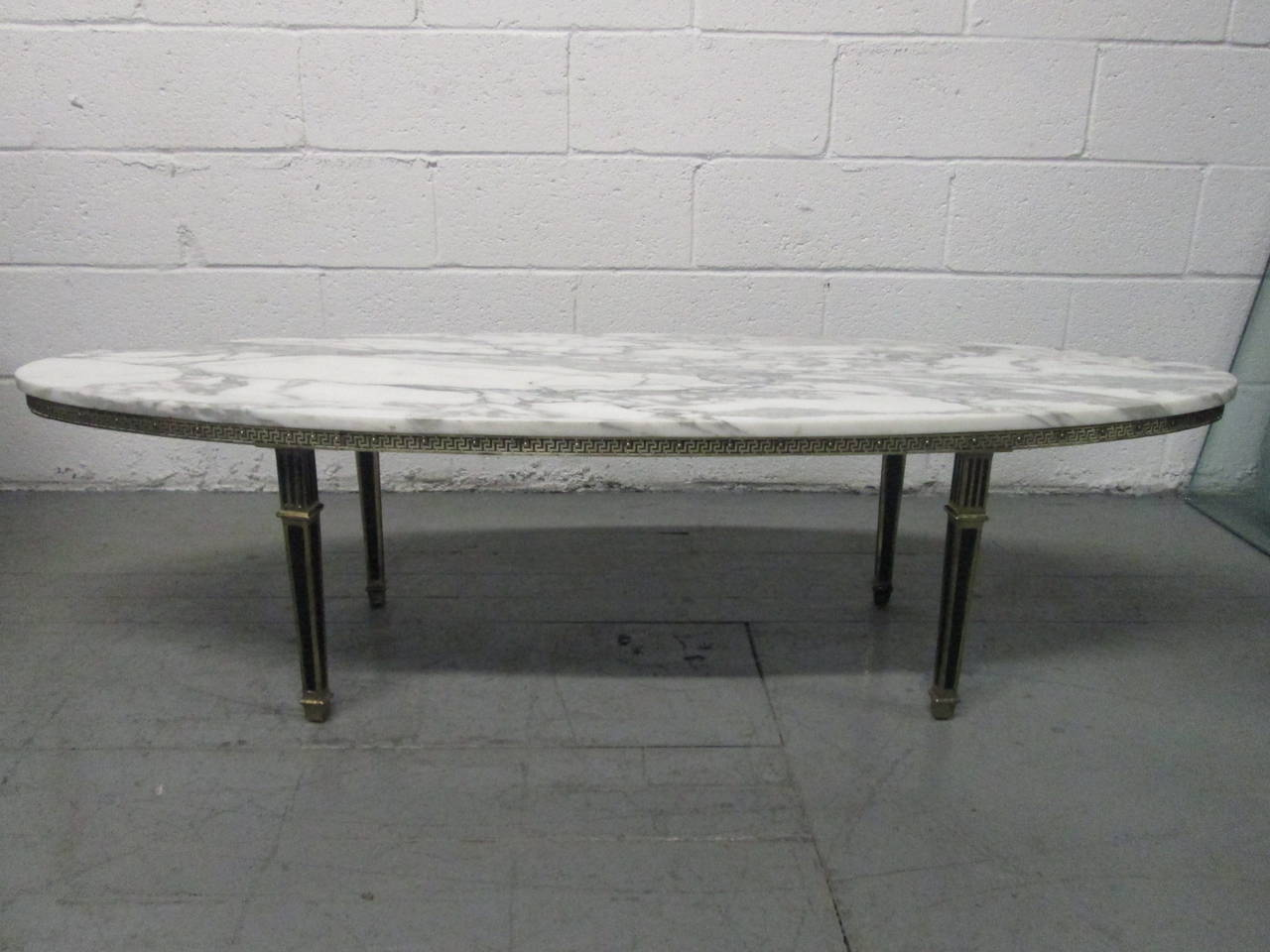hollywood regency oval brass marble-top coffee table for sale at