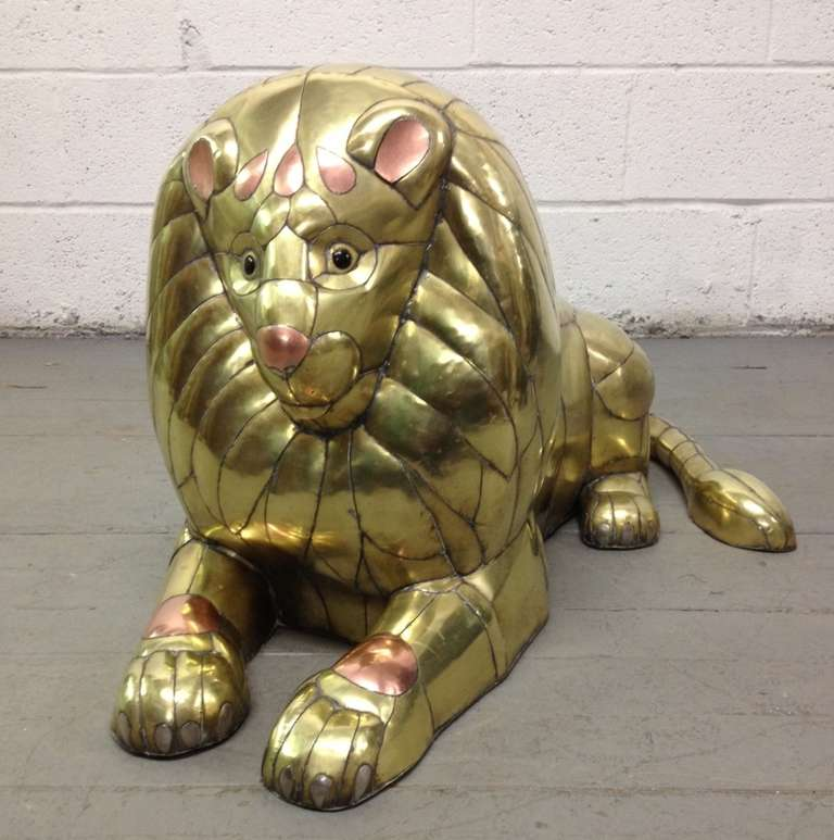 Lion sculpture in patchwork brass and copper by acclaimed Mexican artist and sculptor, Sergio Bustamante. This was done in the late 1970s. Tons of handcrafted detail which defines this piece. This is an unsigned example.