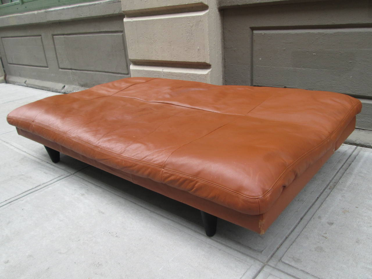 Leather Convertible Sofa By De Sede. The Back Slides Down To Convert Into A  Comfortable