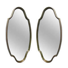 Pair of Mid-Century Modern Sculptural Mirrors with Gilded Frame
