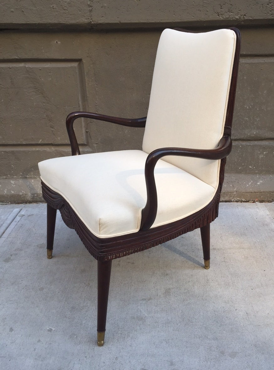 Chairs are newly upholstered in a linen blend fabric. Has a mahogany frame with brass feet.