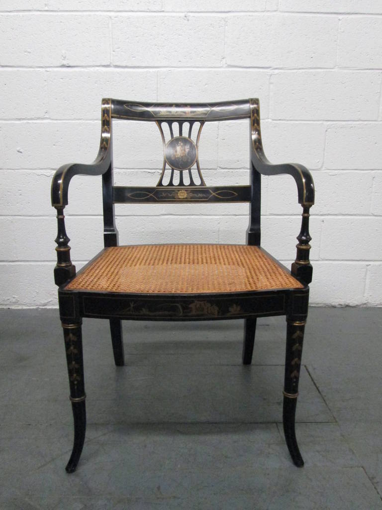 Pair of Sheraton style stenciled armchairs with cane seats.