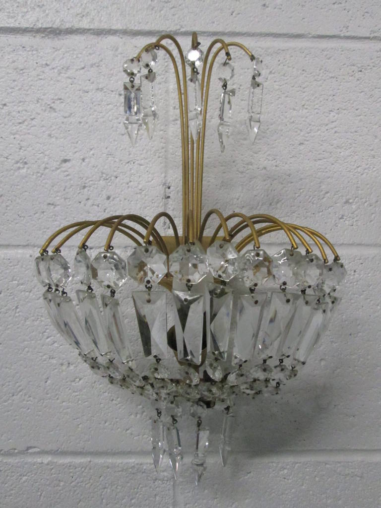 Pair of French gilt bronze and crystal sconces in the style of Maison Baguès.