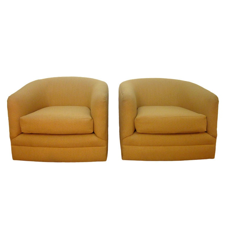 Pair of upholstered barrel back swivel chairs at 1stdibs