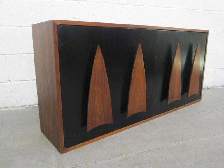 Lovely walnut sculpted handles, doors are black lacquered, has adjustable shelves with two pull out drawers inside.