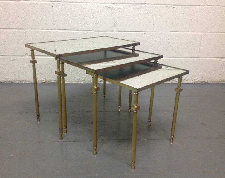 Nest of tables has a mirrored top with bronze legs and bronze trim around the tops.  Larger table measures: 17.25