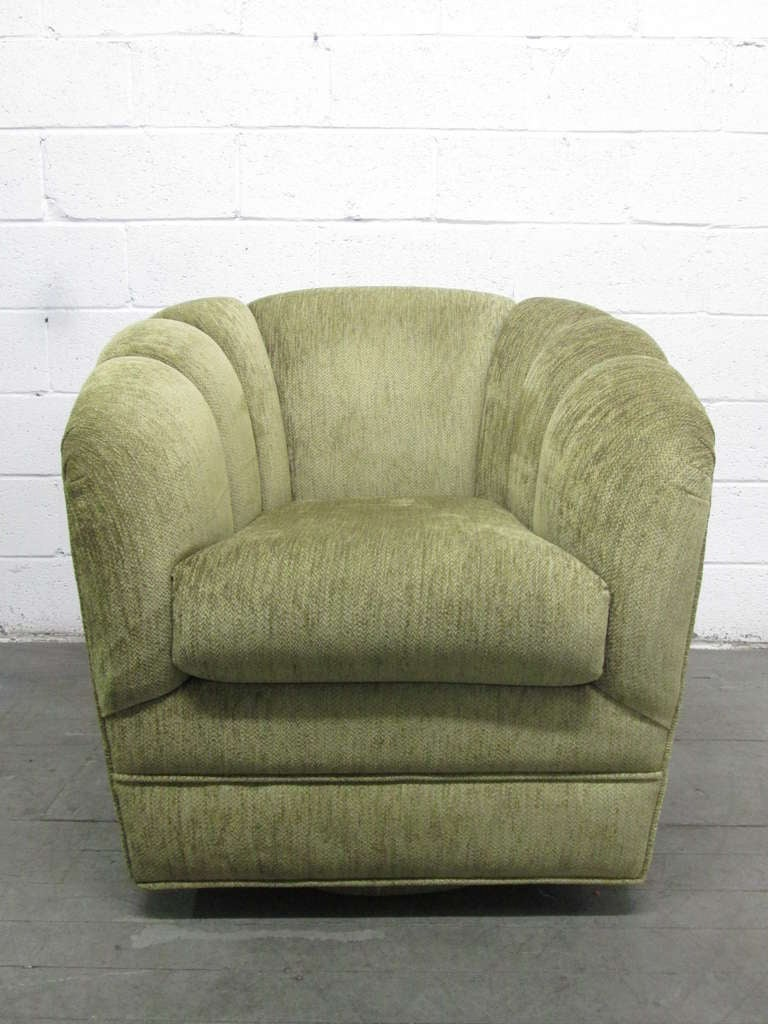 Upholstered swivel lounge chair and matching ottoman at for Matching lounge furniture