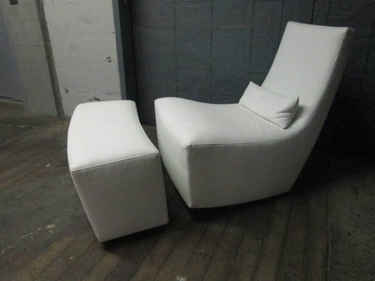 Ligne Roset leather lounge chair and ottoman. Well-made lounge chair with lower backrest. Chair has a slight rocking motion.