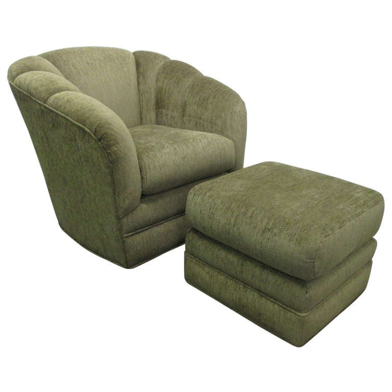Upholstered Swivel Lounge Chair And Matching Ottoman At