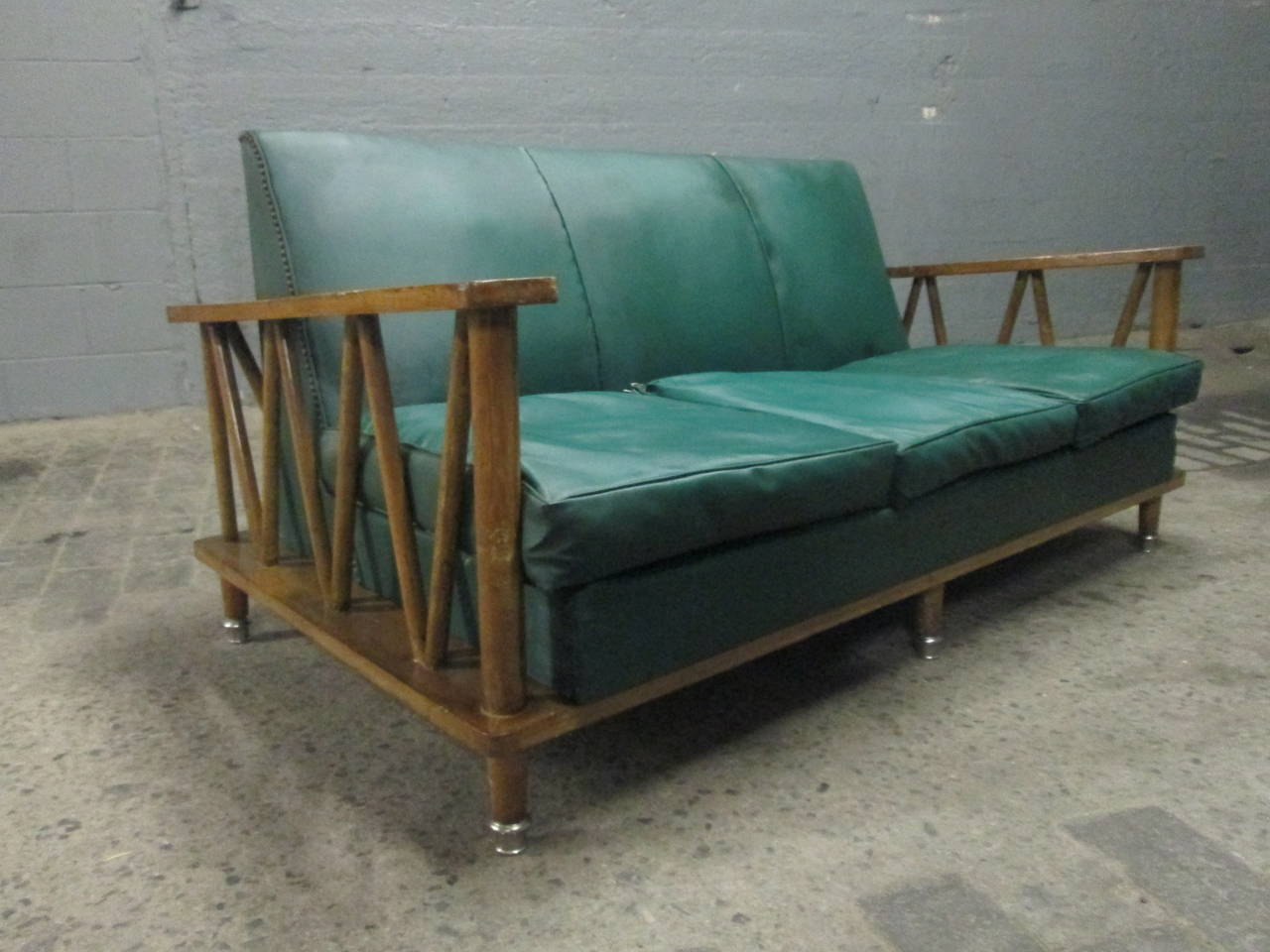 French cerused oak loveseat style of Jean Michel Frank. The feet have steel chrome-plated sabots. Original fabric. There is a pair of matching chairs listed and sold separately.