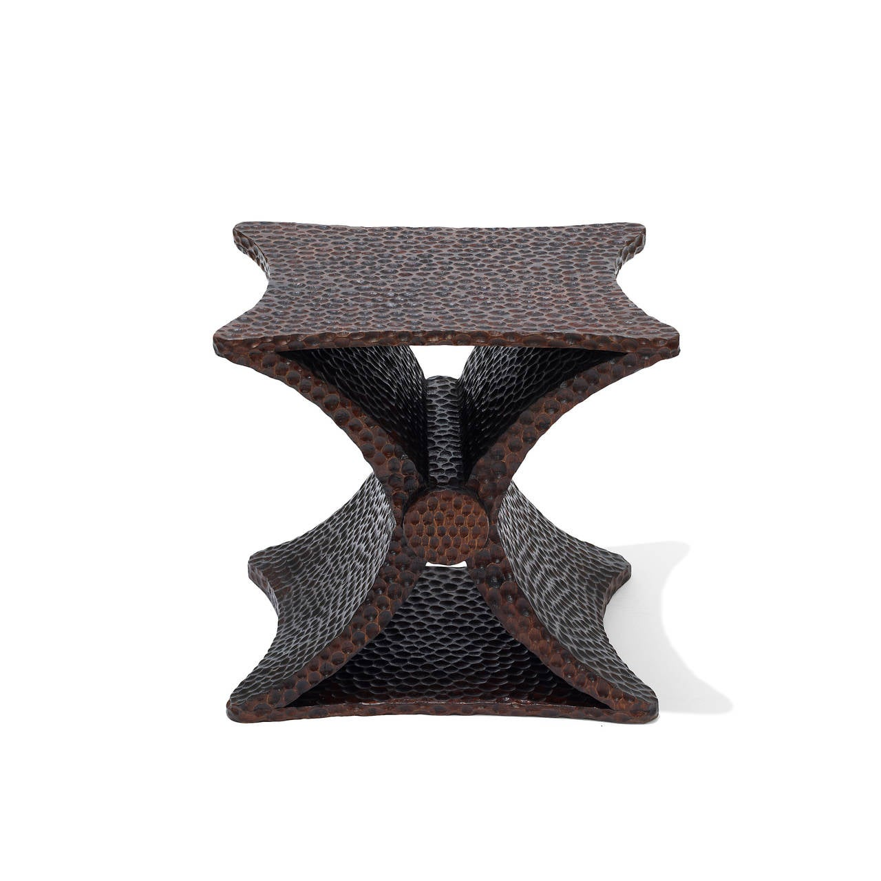 """Pair of Diabolo X-form tables with gouged surface texture by Jean-Michel Frank (1895-1941), in stained oak, Comte, circa 1940. Onenumbered """"8432.""""  (c.f.: Pierre-Emmanuel Martin-Vivier, Jean-Michel Frank: The Strange and Subtle Luxury of the"""