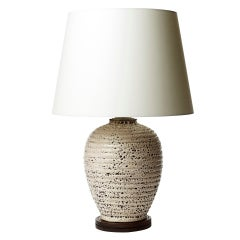 Table lamp with horizontal reeding and textured ivory glaze by Jacques Adnet