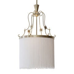 Brass and fringe fixture by Carl G. Hallberg