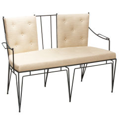 Wrought iron settee and chairs by Marc du Plantier
