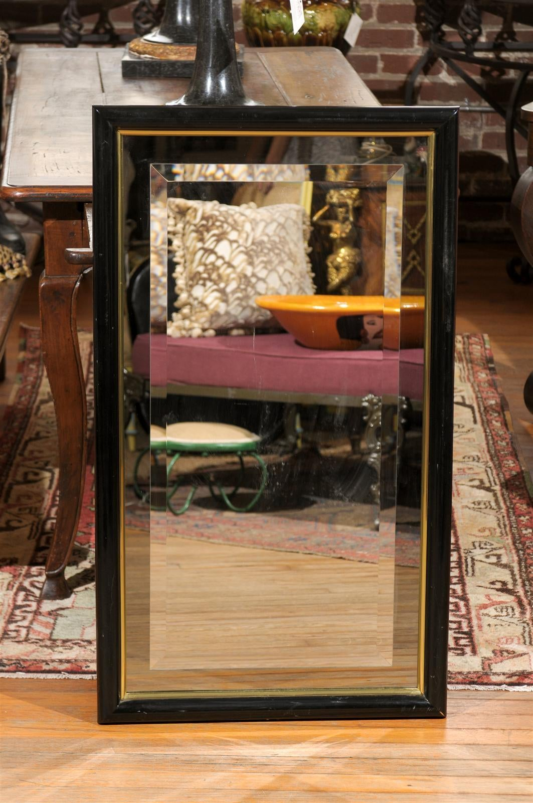 Smoked And Beveled Glass Wall Mirror In A Black And Brass