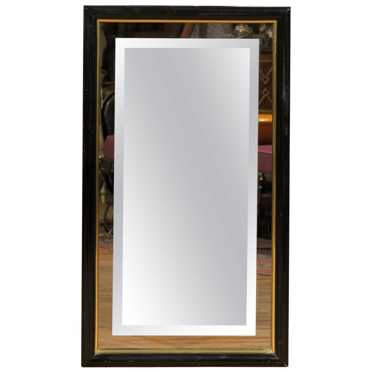 Smoked and beveled glass wall mirror in a black and brass for Glass mirrors for walls