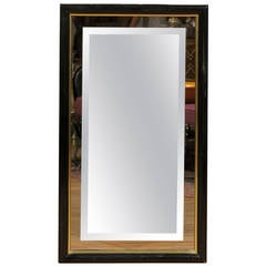 Smoked and Beveled Glass Wall Mirror in a Black and Brass Frame