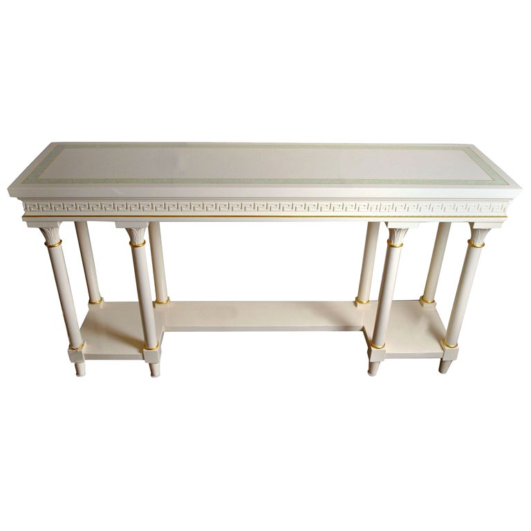 versace style entrance table and matching wall mirror at