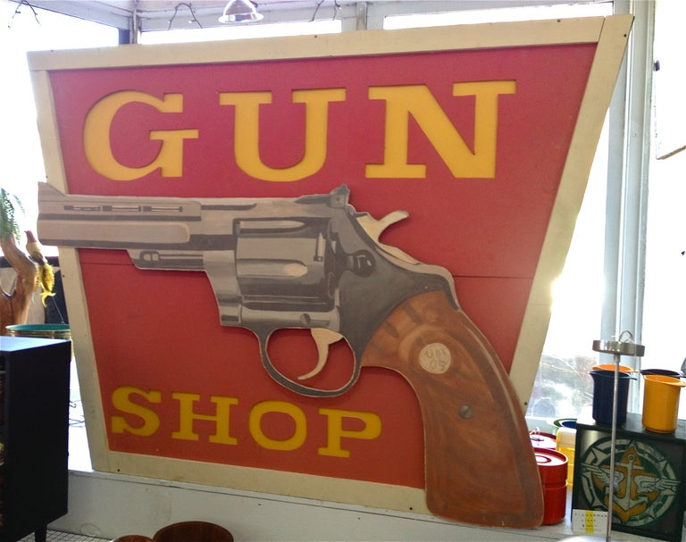 "Vintage original special order ""Gun Shop"" sign. Lights up. Hand painted, made of wood. Sign is made of wood with fluorescent tubes inside. It has hooks on top for hanging. This is a killer piece. Very large.