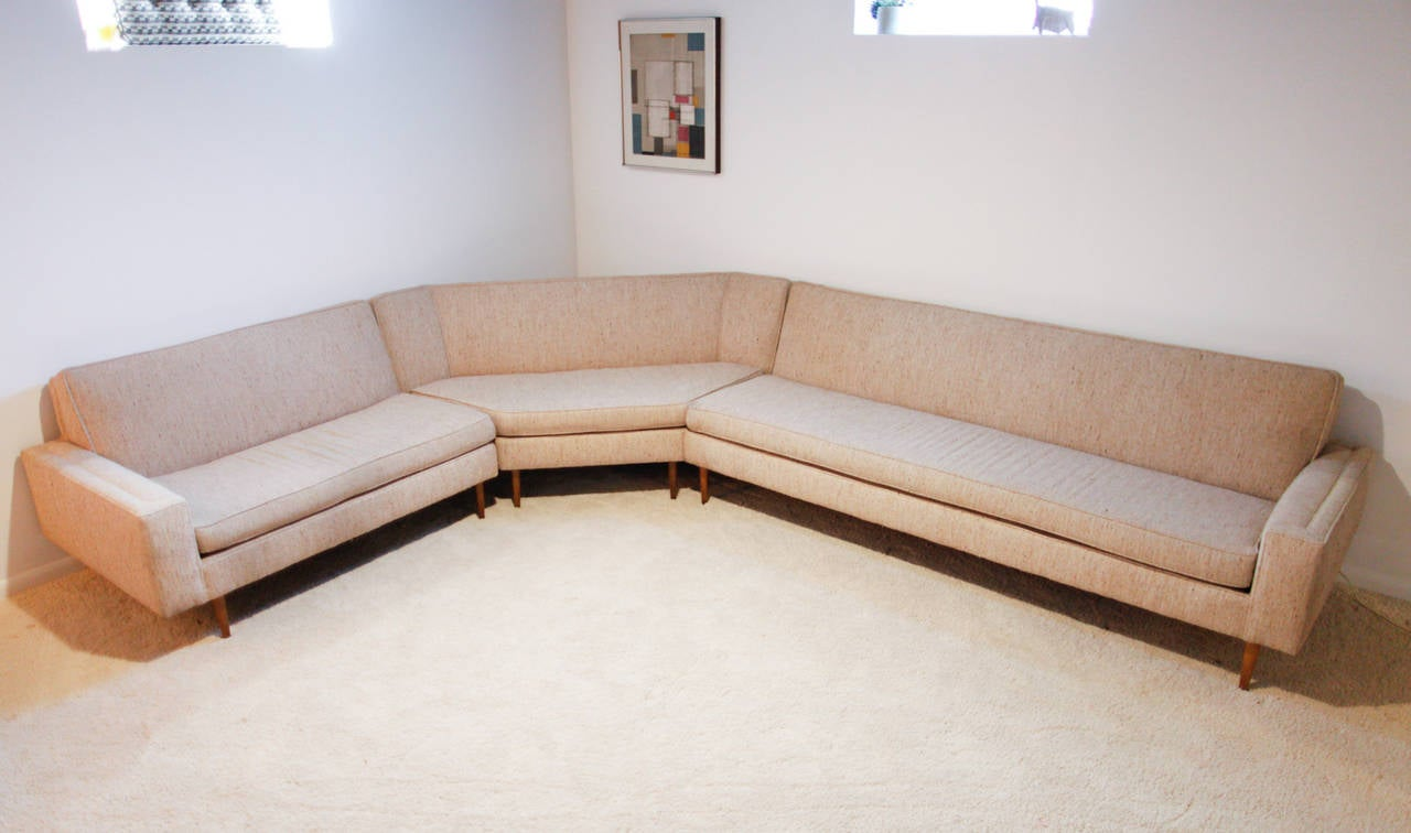 Rare three-piece sectional sofa by Harvey Probber with tall legs. This sofa has the original upholstery but is waiting for your new fabric.