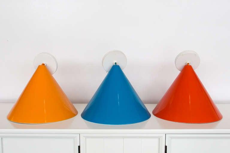 Three Midcentury Arne Jacobsen Pendants by Louis Poulsen. Red, blue and orange. Working condition. Original wiring. Stunning.