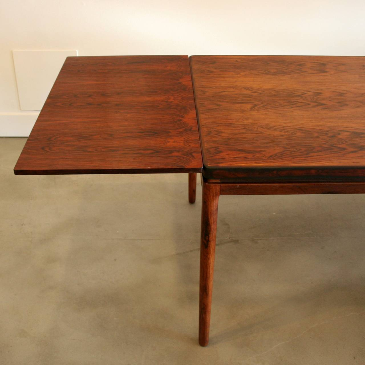 this vintage danish rosewood dining table with two leaves is no