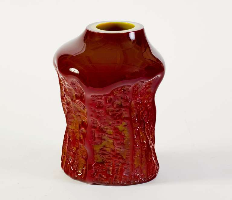 Stunning asymmetrical sculptural vase attributed to Val Saint Lambert of maroon and lemon yellow glass fused together with a textural tree bark finish on the lower two thirds of the vase. Upper Vase is high gloss smooth finish with a circular lemon