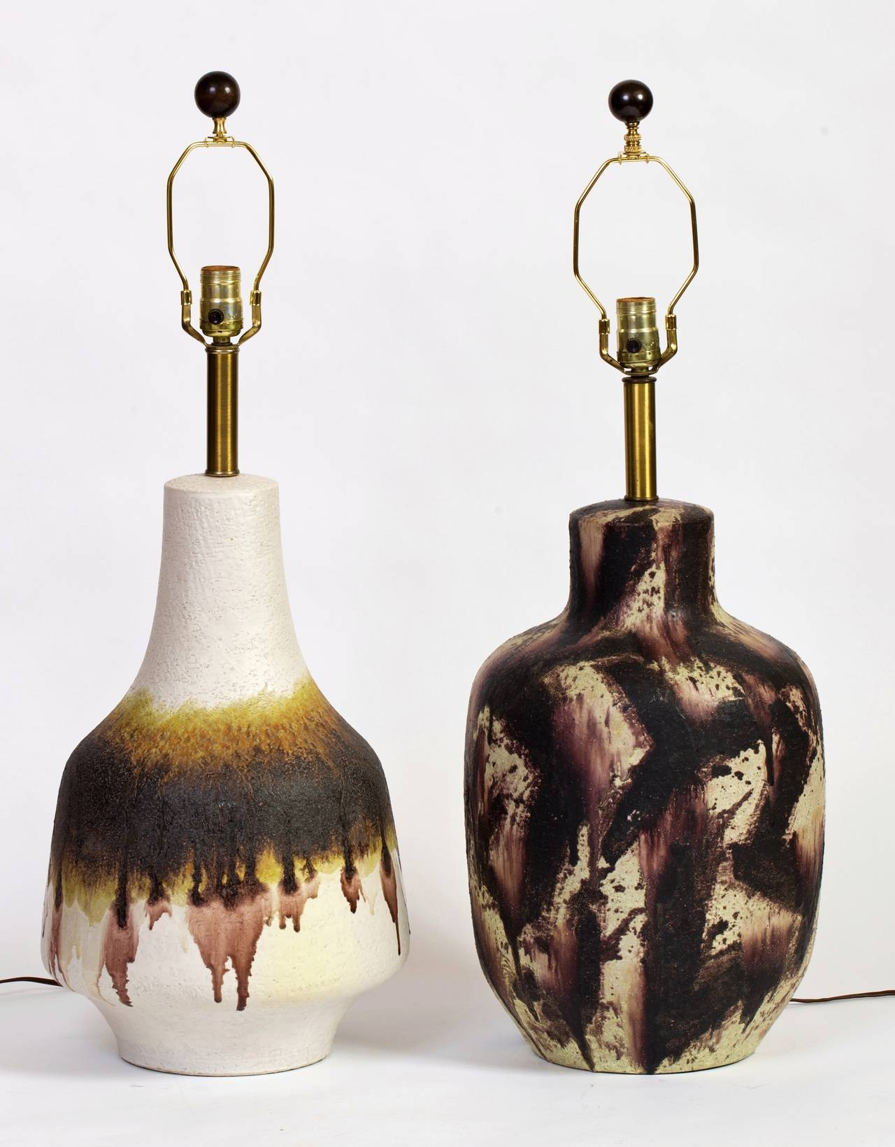 Unique pair of mismatched Fantoni ceramic lamps for Raymor. Beautiful scale and design from the layered drips to the abstract pattern. The off white lamp is signed, Fantoni, Italy for Raymor, the other unsigned.   Each lamp is 31 inches high with