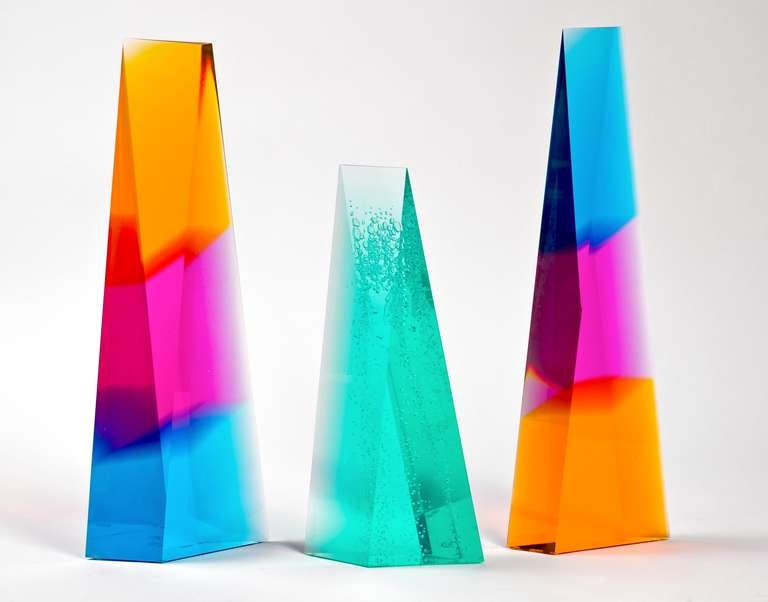 Lucite sculptures by renowned New York artist Norman Mercer. Two extra large tri-colored sculptures have reverse Blue, Pink and Gold colors and one Green Sculpture features controlled bubbles.  Each sculpture is a three-dimensional piece of art that