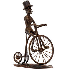 Pair of Outsider Art Sculptures of a Bicyclist and a Hunter, circa 1900s