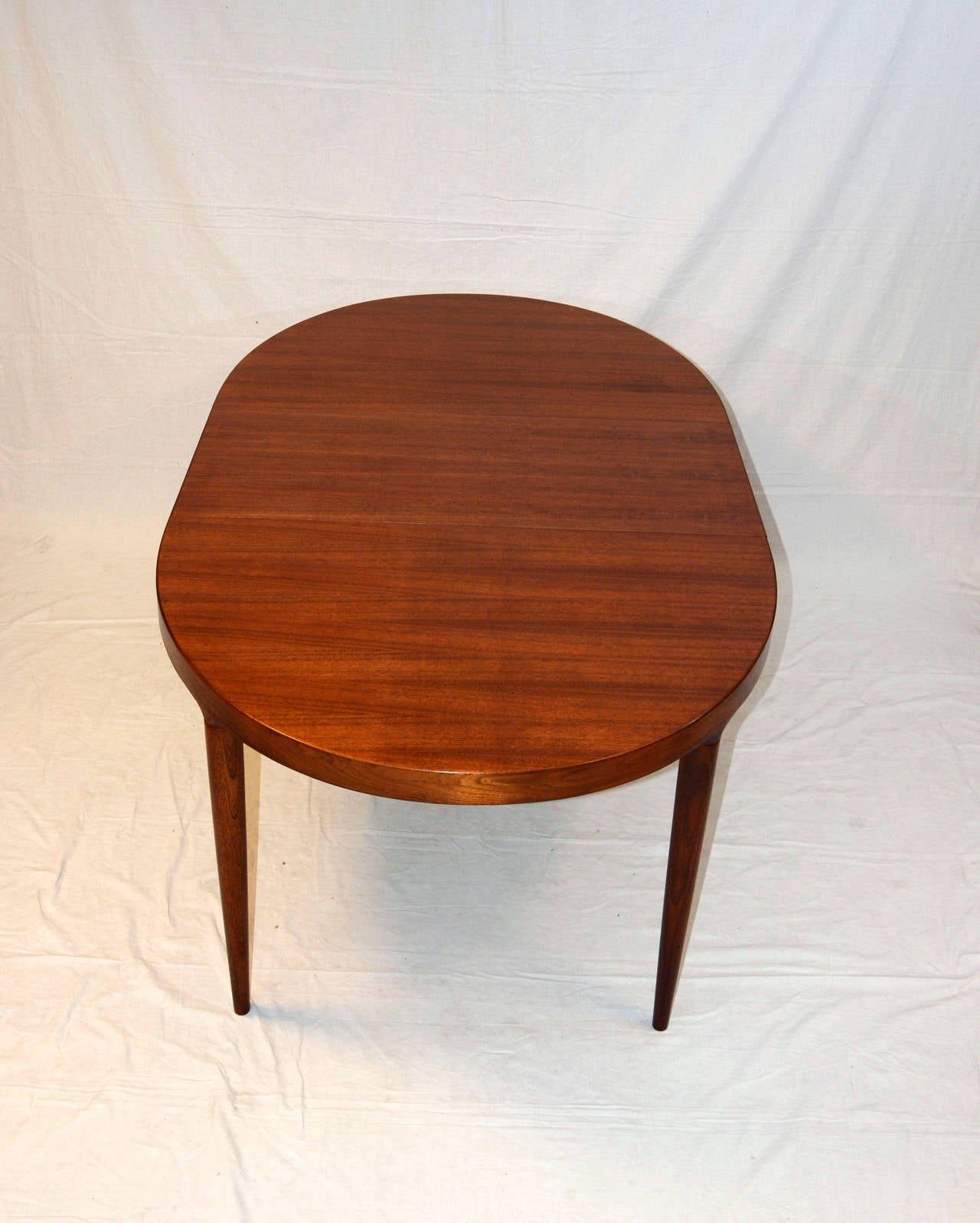 Mid Century Danish Walnut Oval Dining Table by Moreddi Co at 1stdibs