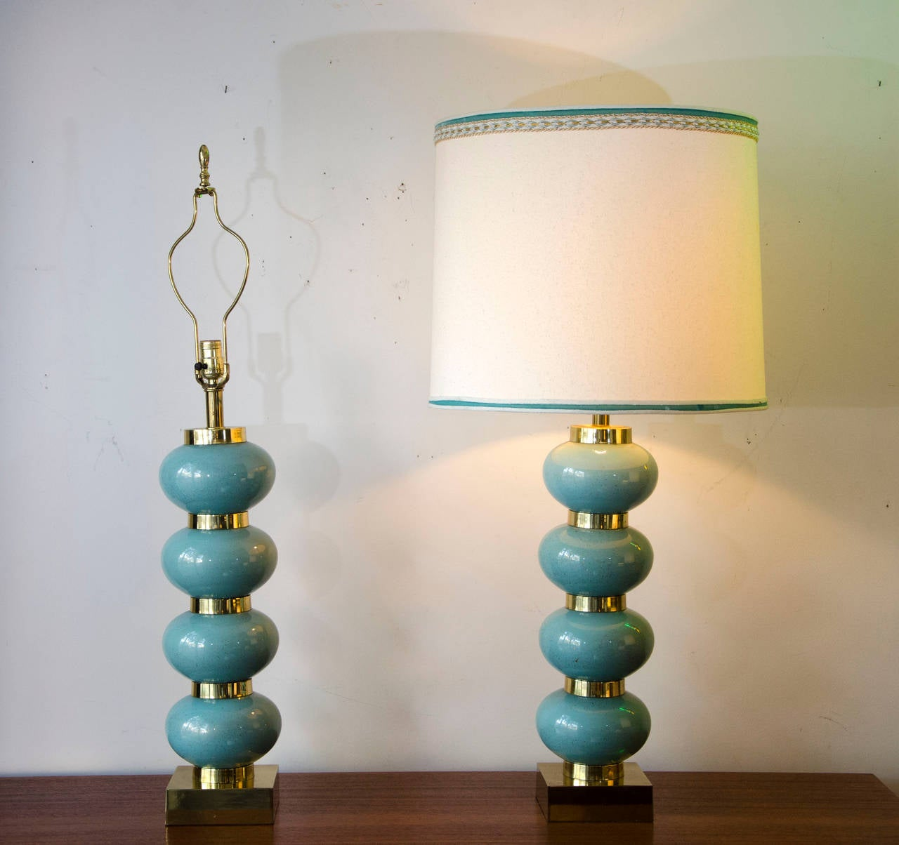 Pair Of Lamps In The Mid Century Hollywood Regency Style, Each Base  Consists Of Four